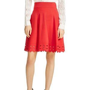 Maje cut out hem June red rubbed knit mini skirt